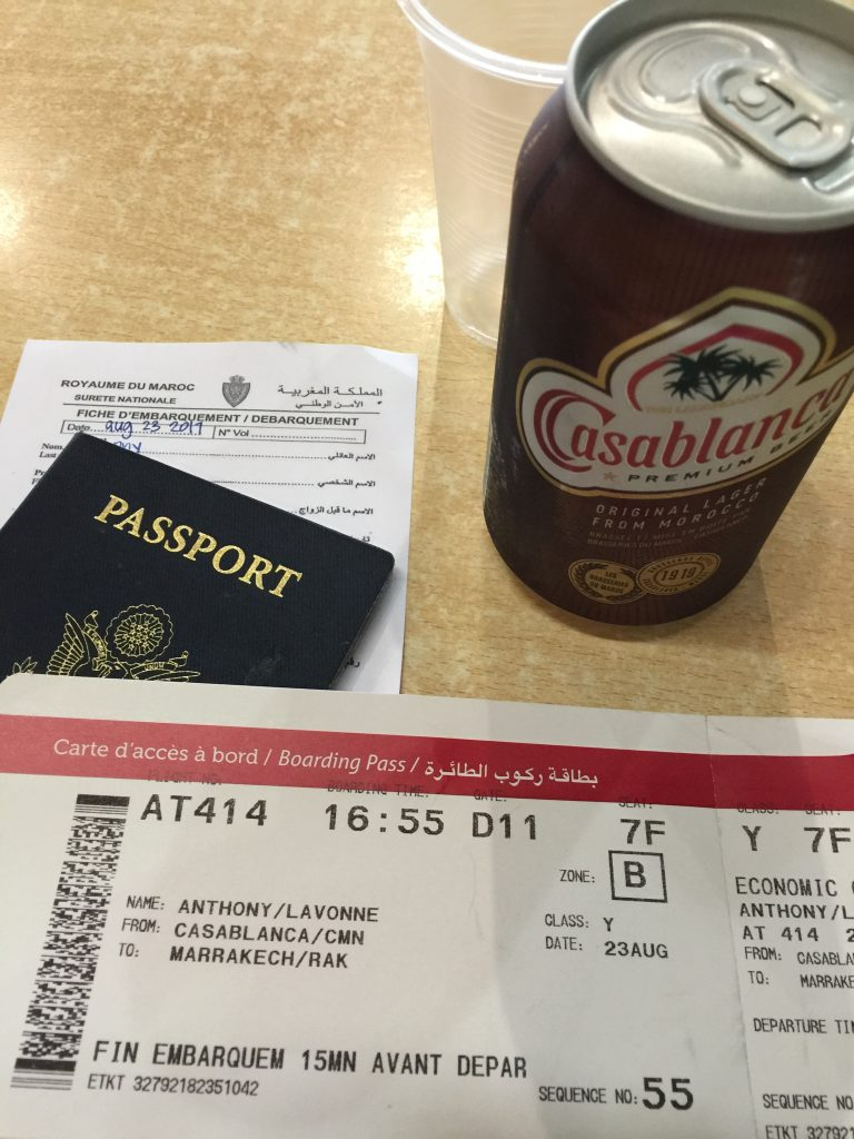 casablanca airport boarding pass and a casablanca beer